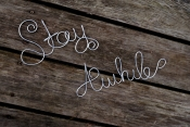 stay awhile wire sign
